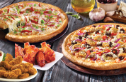 Any Medium Chicken Pizza + 10 Wings $21.95